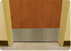 Photo Of An Installed Stainless Steel Kick Plate On A Wooden Door
